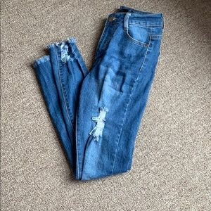 Fashion Nova distressed jeans